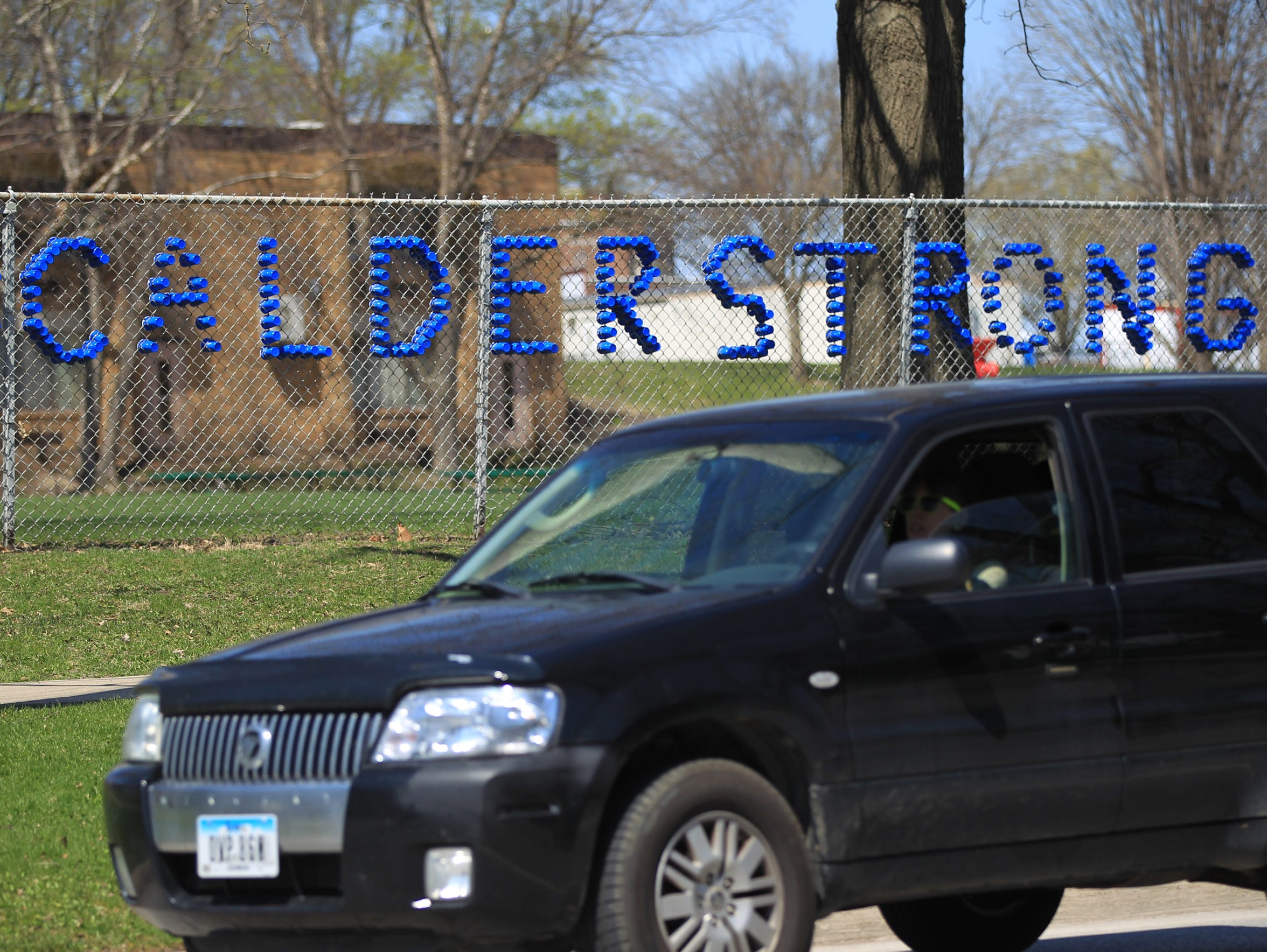 """#CalderStrong"" is seen displayed outside Hoover Elementary"