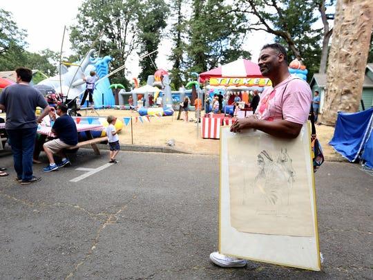 Sanford Webb, 52, of Portland, carries a Homer Davenport