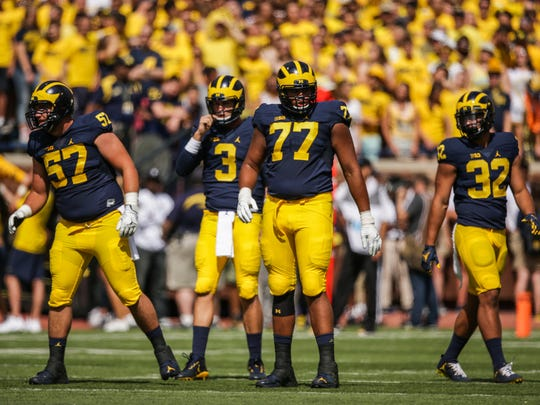 Michigan Wolverines players, including Patrick Kugler (57), Wilton Speight (3), Grant Newsome (77) and Ty Issac (32) line up against Hawaii during the opener at Michigan Stadium in Ann Arbor on Saturday, Sept. 3, 2016.