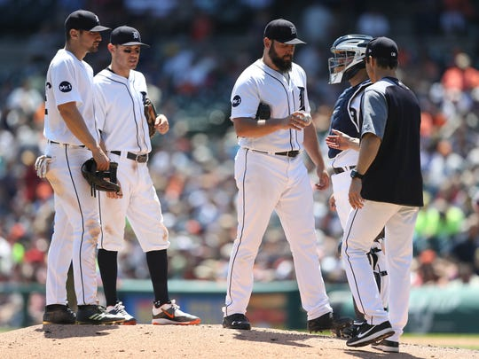 Tigers manager Brad Ausmus takes pitcher Michael Fulmer