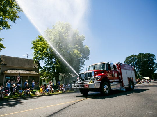 The Polk County Fire District sprays water to cool off the crowd at the Fourth of July Grand Parade on Tuesday, July 4, 2017, in Independence. The parade started at Western Oregon University in Monmouth and made its way to Riverfront Park in Independence.