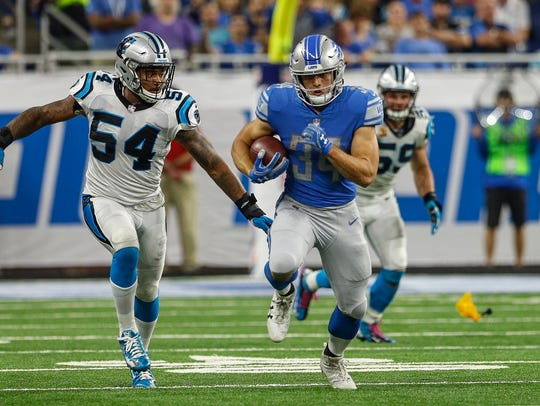 Zach Zenner picks up yardage in the first half of the Detroit Lions' 27-24 loss to the Carolina Panthers at Ford Field on Oct. 8, 2017.