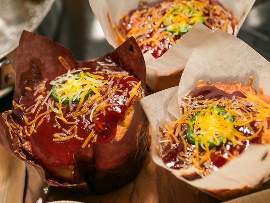 Brisket and Cheddar Stuffed Cornbread Muffins. The muffins include smoked brisket, cheddar cheese and jalapeno peppers baked into a corn muffin.