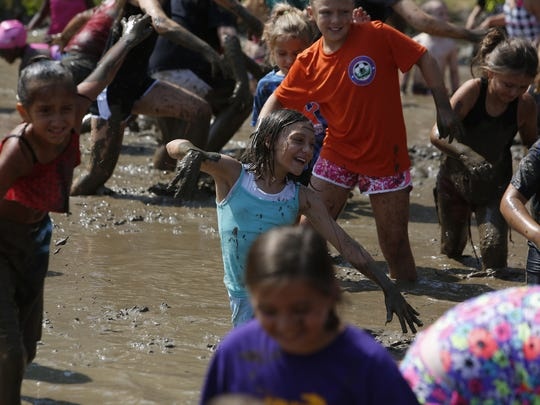 As one of the first challenges of the day, the children were told to run across the mud pit to their opposite side as fast as possible.
