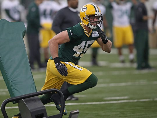 Packers rookie linebacker Vince Biegel runs a drill during rookie camp Friday, May 5, 2017 inside the Don Hutson Center.