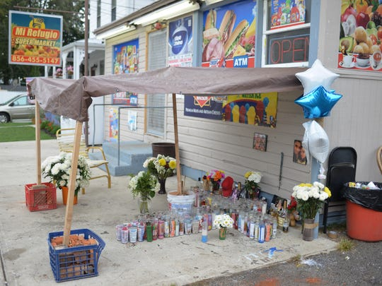 Friends and family of Kevin Carrillo have a set up a memorial to him outside the Cottage Avenue store where he was murdered last week, Tuesday, Sep. 27, 2016 in Bridgeton.  They plan to gather at 7:30 pm Tuesday for a vigil at the site.