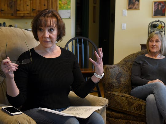 Tara Coy, left, Rhanda Parks, right, and other residents of Sharps Chapel said Friday, March 3, 2017, that utility spraying last summer caused illnesses and killed vegetation in their subdivision.