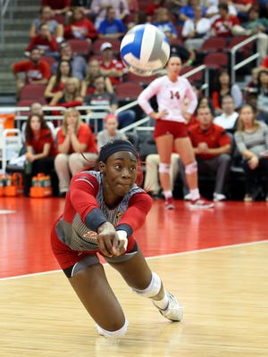 Louisville's Janelle Jenkins makes a diving play.     Sept. 9, 2014