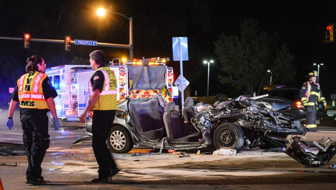 Emergency crews had to cut apart a car to extricate a passenger Friday night after a crash at College Avenue and Prospect Road.