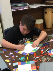 From left, Niagara Elementary students Abbie Burklow, Jacob Edds and Grace Bumgardner  work on an art project created and delivered by parent volunteer Chris Plummer.