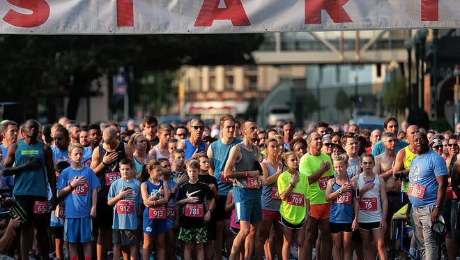Runners begin the 15th annual Chick-fil-A 5K downtown in front of Autozone Park. Thousands of runners turned out for a little Labor Day fun and to support Junior Achievement, which is dedicated to providing economic and business education to local K-12 students.