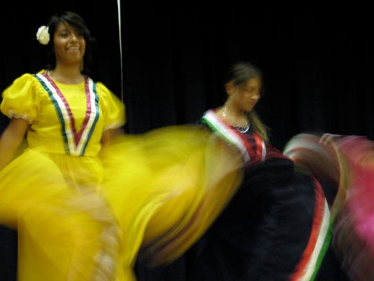 Women dance during a St. George celebration of National