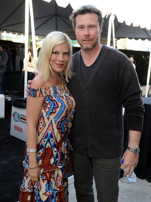 ORG XMIT: 141069112 WEST HOLLYWOOD, CA - MARCH 11: Actress Tori Spelling and Dean McDermott attend John Varvatos 9th Annual Stuart House Benefit presented by Chrysler held at John Varvatos Los Angeles on March 11, 2012 in West Hollywood, California.  (Photo by Michael Kovac/Getty Images for John Varvatos) ORIG FILE ID: 141147879
