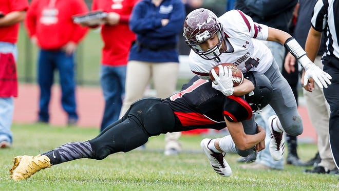 Newark Valley's Tyler Beebe trips up Sidney's Liam Matthews in the first quarter at Newark Valley on Saturday, October 14, 2017. 