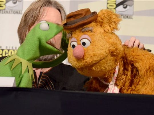 "Kermit the Frog, left, puppeteer Steve Whitmire, and Fozzie Bear attend ""The Muppets"" panel on day 3 of Comic-Con International on Saturday, July 11, 2015, in San Diego."