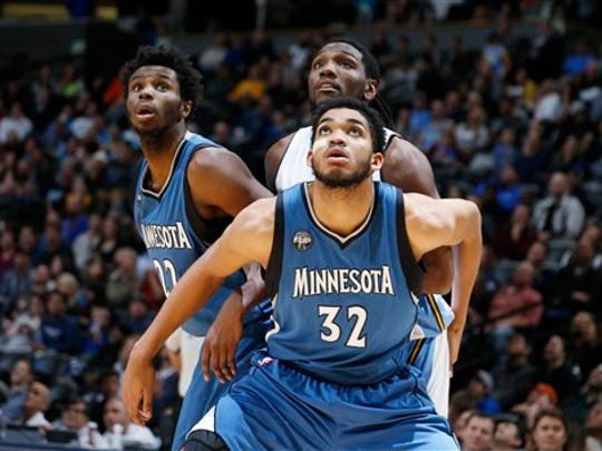 Minnesota Timberwolves center Karl-Anthony Towns (32), front, boxes out Denver Nuggets forward Kenneth Faried (35), center.