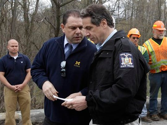 Gov. Andrew Cuomo, right, and aide Joseph Percoco tour