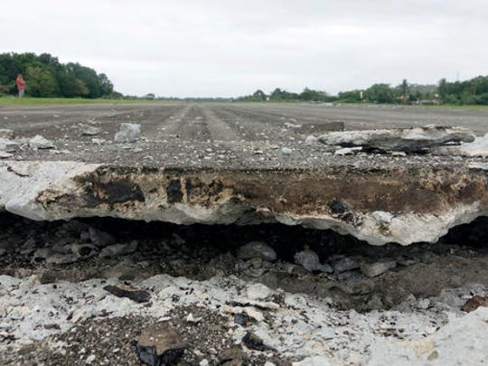 A damaged runway of Surigao City Airport is seen Saturday, Feb. 11, 2017 following a powerful nighttime earthquake that rocked Surigao city, Surigao del Norte province in southern Philippines. The late Friday quake roused residents from sleep in Surigao del Norte province, sending hundreds to flee their homes.