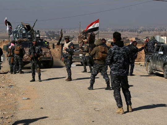 Iraqi Federal police deploy after regaining control of the town of Abu Saif, west of Mosul, Iraq, Wednesday, Feb. 22, 2017. The battle for Mosul, backed by the U.S.-led coalition, has already driven the militants from the eastern half of the city, which is divided roughly in half by the Tigris River.