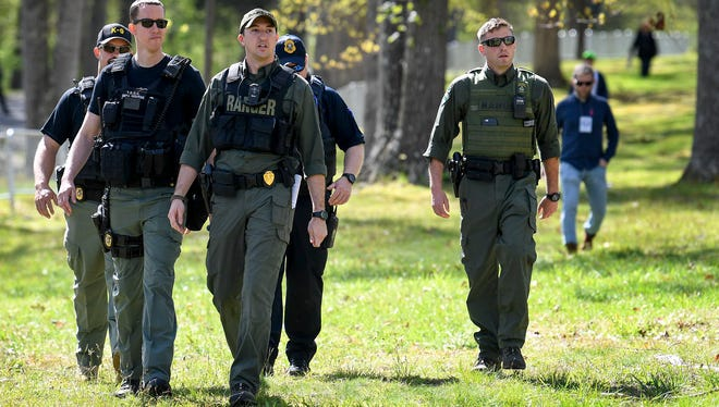 Park rangers are joined by law enforcement to patrol the park where anti-racist organizations gather to protest the annual American Renaissance conference at the Montgomery Bell State Park in Burns, Tenn. on April 28, 2018.