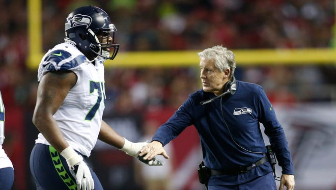 George Fant played basketball in college, but he ended up starting at left tackle last season for coach Pete Carroll's Seahawks. Carroll believes Fant will prove to be the most improved player in the league this year.
