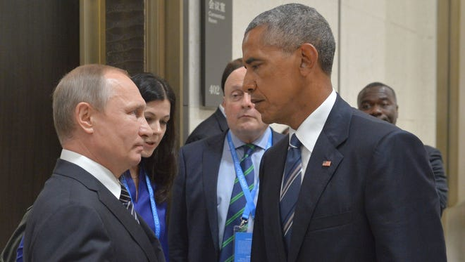 Russian President Vladimir Putin speaks with  President Obama in Hangzhou , China on Sept. 5, 2016. In a private meeting, Obama warns Putin over Russian hacking into U.S. elections.