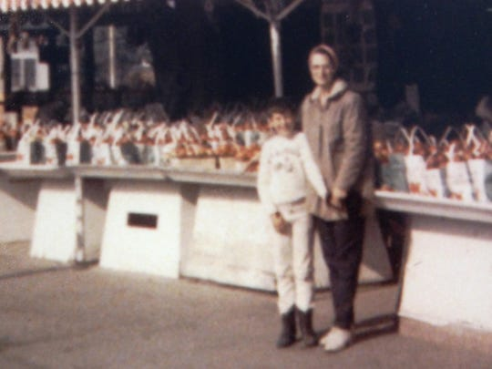 A young Joe Maiorana Jr. stands with his grandmother, Frances, in front of the Maiorana Orchards fruit stand in the early-1960s.