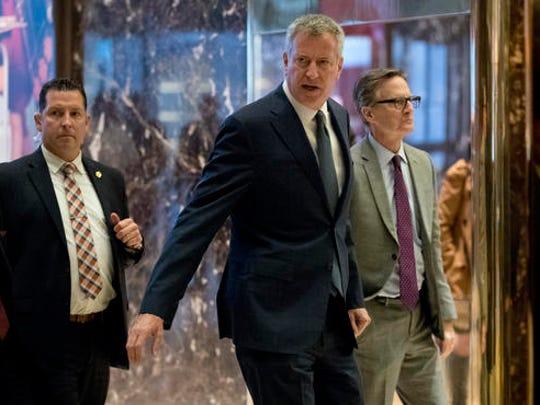 New York City Mayor Bill de Blasio arrives at Trump Tower, Wednesday, Nov. 16, 2016, in New York.