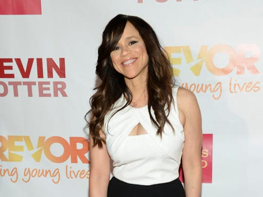 FILE - In this June 15, 2015 file photo, actress Rosie Perez attends TrevorLIVE New York to benefit The Trevor Project at the Marriott Marquis, in New York. Perez will join New York Mayor Bill de Blasio, the Rev. Al Sharpton and other celebrities including Mark Ruffalo,  and Michael Moore are planning to rally New Yorkers to stand up to President-elect Donald Trump on the eve of his inauguration, organizers said Saturday.