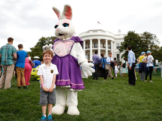 Michael McGee, 5, poses with an Easter bunny during the White House Easter Egg Roll on the South Lawn of the White House in Washington, Monday, April,17, 2017. President Donald Trump and first lady Melania Trump are set to host the official annual Easter egg roll at the White House.