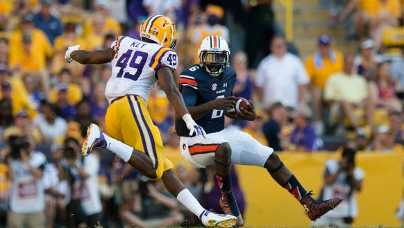 Auburn Tigers quarterback Jeremy Johnson (6) runs downfield