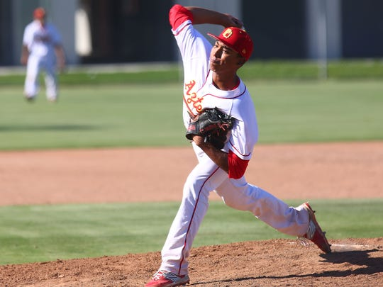 Jeremiah Estrada pitches for Palm Desert during their win over Paso Robles, May 20, 2015.