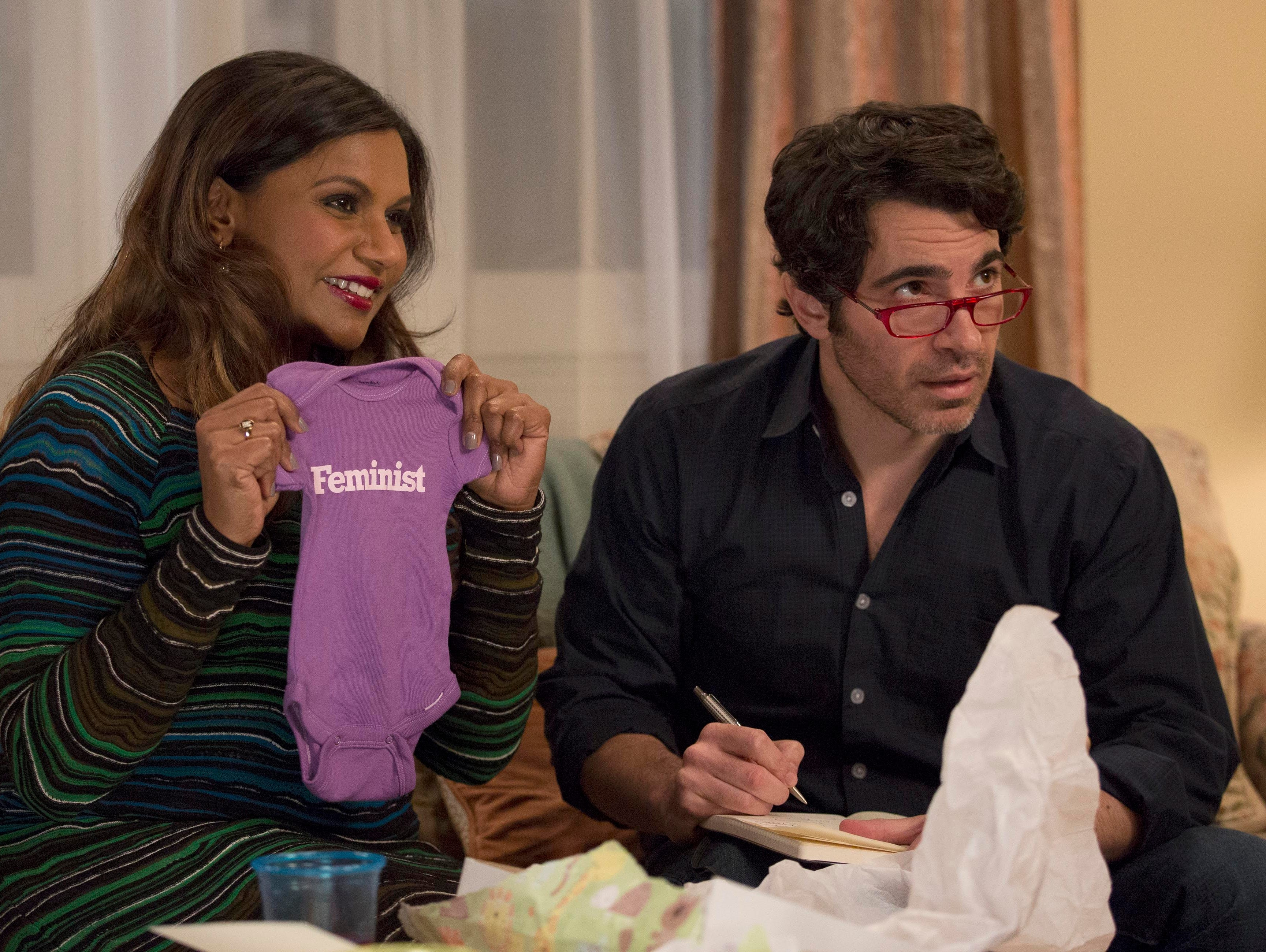 Danny (Chris Messina) helps Mindy (Mindy Kaling) open gifts at her baby shower in the season finale