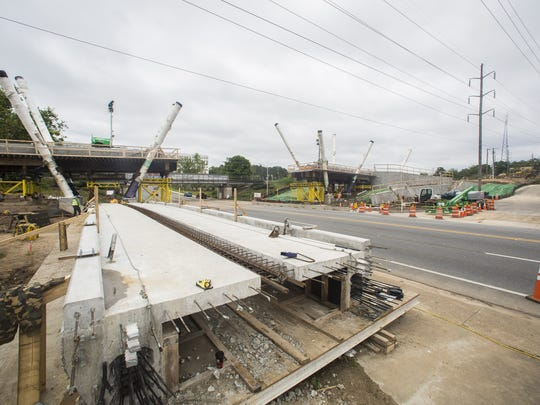 Installation of the Capital Cascades Crossing pedestrian bridge closed South Monroe Street between FAMU Way and Gaines Street overnight. The roadway will be closed again tonight starting at 10 p.m. until 5 a.m. on Sunday.