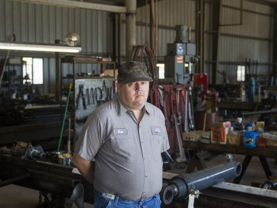 Ken Bell stands inside the shop of Capital Hydraulics, the family owned business has specializes in hydraulic repair for over 50 years.