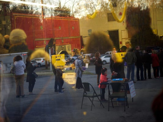 Voters line up in and outside of the Valley Forge Volunteer Fire Company polling station on Election Day in Valley Forge, Pa.
