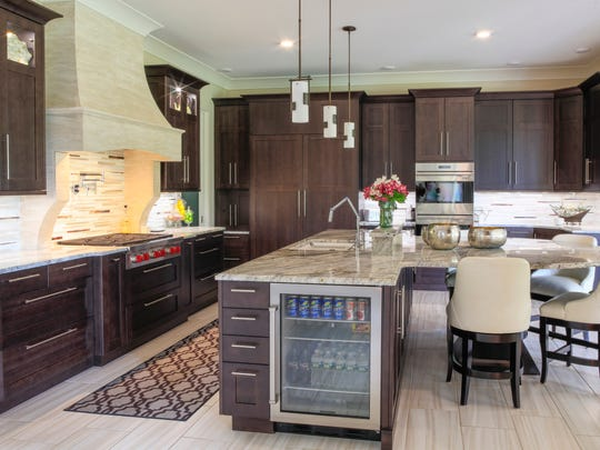 In the kitchen, local artist Rick Muto faux-painted the hood above the stove and also did a ceiling and bathtub surround in the master bathroom.