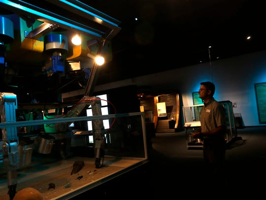 "Museum director Bart Wilsey examines a full-scale replica of Zeus, an underwater robotic submarine, during a tour of the ""Shipwreck! Pirates & Treasure"" exhibition Thursday at the Farmington Museum at Gateway Park."