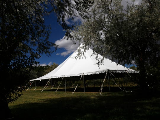 A large tent used by Enchanted Celebrations stands