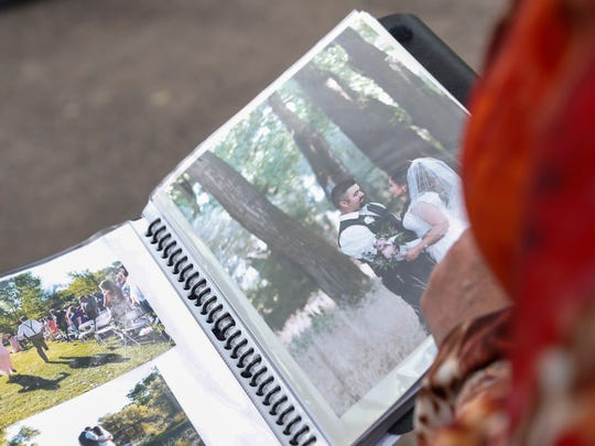 Enchanted Celebrations owner Kandice Cochrane on Monday shows an album filled with photos of events she has hosted in Aztec.