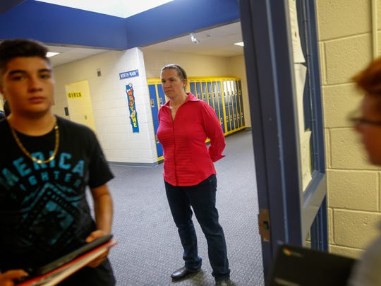 Mesa Alta Junior High School math teacher Jennifer Augustine greets her students Thursday.