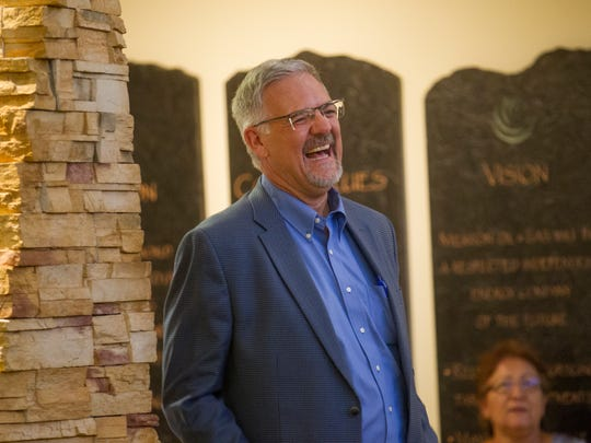 Wally Drangmeister, president of Path Three Marketing, is introduced as a guest speaker Thursday during a New Mexico Business Coalition event at Merrion Oil and Gas in Farmington.