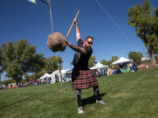 Cory Black prepares for his heave during the sheaf toss competition Saturday during the Aztec Highland Games and Celtic Music Festival at Riverside Park in Aztec.