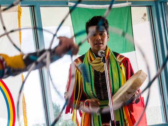 Anthony Hunt sings during a hoop dance demonstration, Monday during Indigenous Peoples Day celebrations at San Juan College in Farmington.