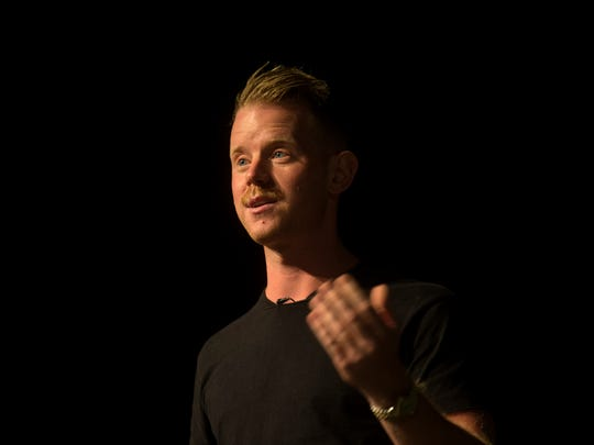 George McGraw, founder and executive director for DigDeep, a non-profit organization in Los Angeles, Calif.,  speaks, Tuesday, Oct. 10, 2017 at San Juan College's Little Theater in Farmington.