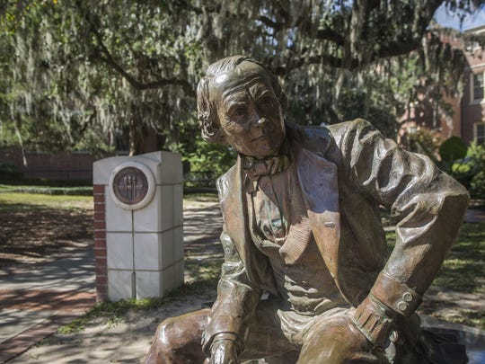 A statue of Francis Eppes sits next to Westcott Fountain and is near Eppes Hall on FSU campus.