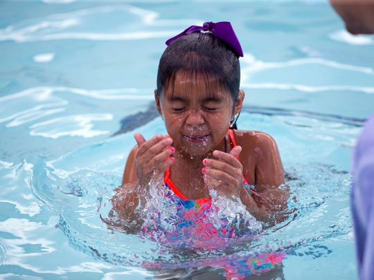 Emilie Muniz, 7, learns how to hold her breath and