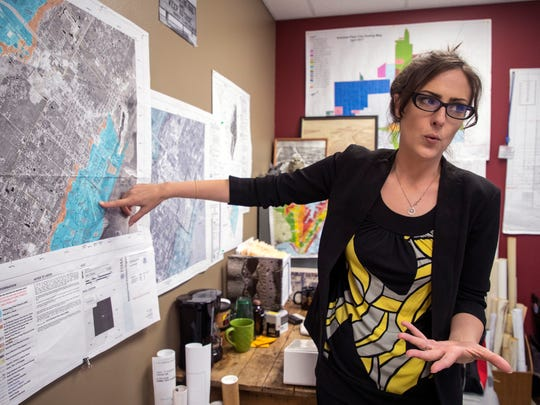 Kat Comeaux, superintendent of development services for Aransas Pass, points out sections of the city that would be in a special flood hazard zone under the proposed flood zone maps on July 11, 2018. The city's levee was decertified after it was determined it was built from dredge materials.