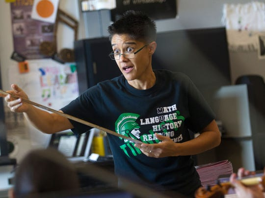 """Farmington High School orchestra director Monica Leaming put together a group of her string musicians to perform as part of the """"Beatles vs. Stones -- A Musical Showdown"""" traveling show."""