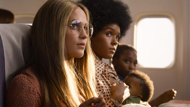 """This image released by LD Entertainment and Roadside Attractions shows Alicia Vikander as Gloria Steinem, left, and Janelle Monae as Dorothy Pitman Hughes in a scene from """"The Glorias."""""""